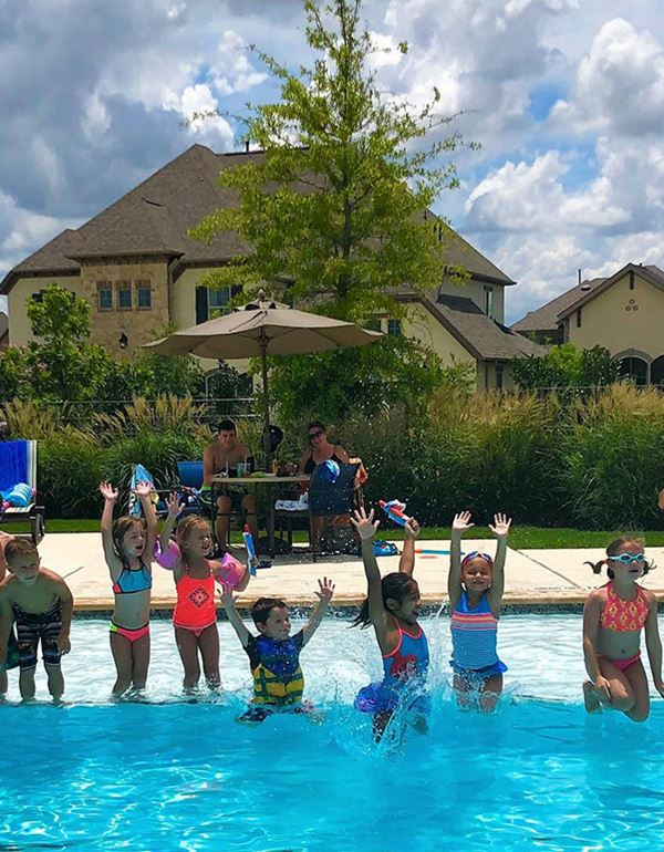 Elyson community residents splashing in pool