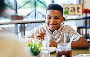 Boy enjoying a meal at Elyson Cafe Restaurant Katy, Texas