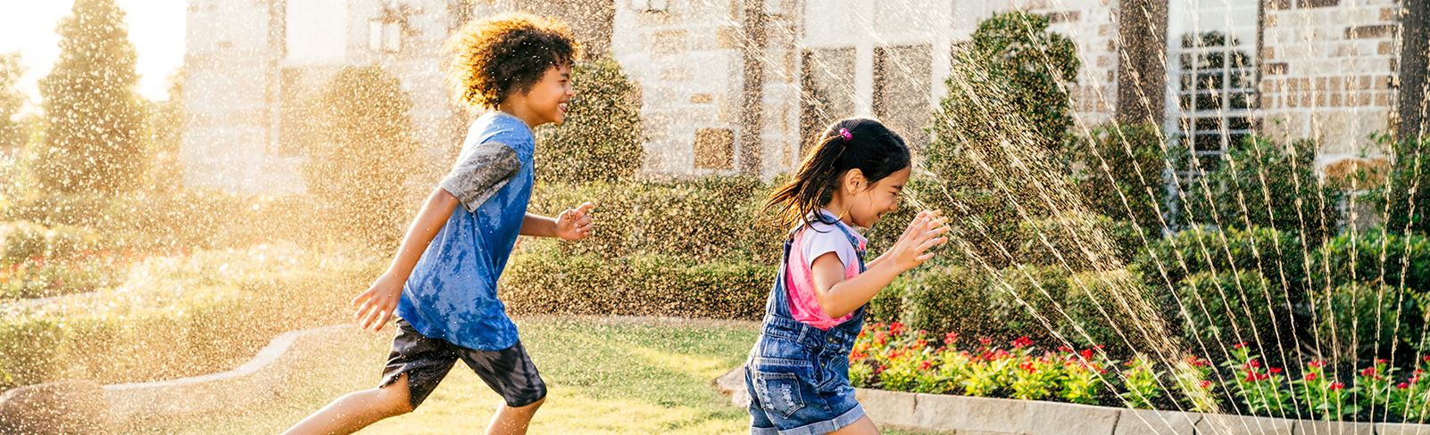 Kids playing in new home in Katy, TX at Elyson master-planned community