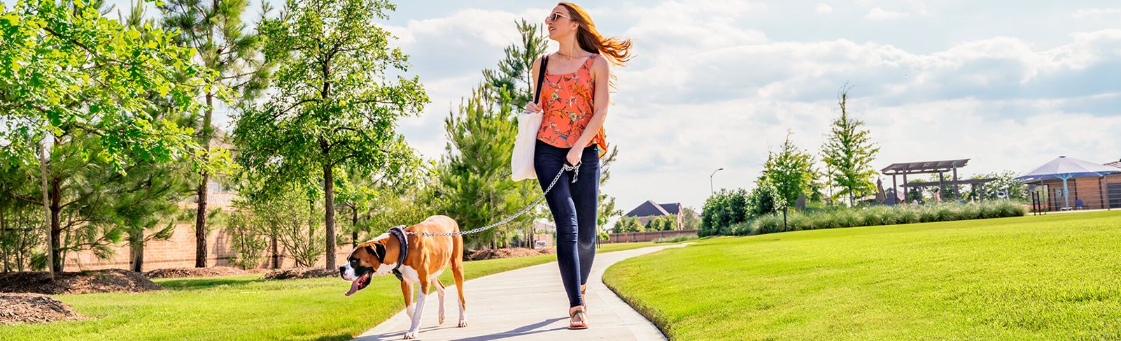 Elyson resident walking dog in Elyson community Katy, TX