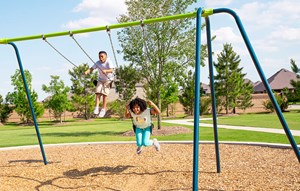Kids on the playground at Elyson community in Katy, Texas