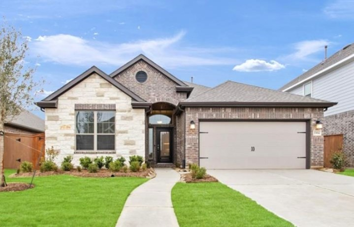 Chesmar Homes Cypress Plan in Elyson Katy, TX - New Home at 23814 Northwood Terrace Lane Exterior