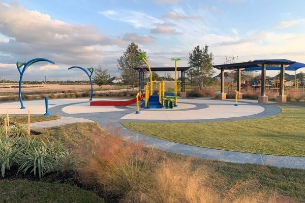 Elyson splash pad and park amenity.